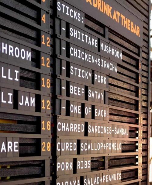 longsong, letter menu board, bar menu, black tiles, white letters, orange letters